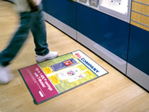 Windo� poster displays provides the complete in-store advertising solution to increase sales by communicating your message on unused floor and counter surfaces. This unique and inescapable medium stands out to increase brand awareness.